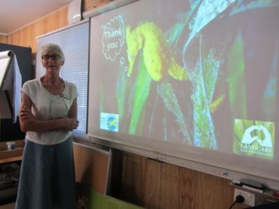 "Janet with her OCCI presentation as part of ""Native Plants Beyond the Shore"""